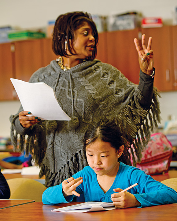 Under the supervision of Buffalo City Schools teacher Shanoda Davis, third-grader Ryana Flores participates in an academic enrichment program supported by Say Yes. The after-school program, which seeks to enhance pupils' math and English skills, is operated through a private-public partnership with the YMCA of Buffalo Niagara.