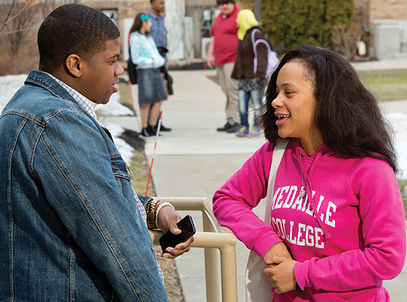 Dennis Blakely and Amber Gray are students at Medaille College in Buffalo, and both say their Say Yes scholarships made college possible. Gray, a pre-veterinary student who seriously considered moving away from Buffalo, now plans to remain in the area.