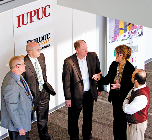 Cooperative leadership is vital to the success of the Columbus coalition. Conferring here are (from left): Joe Fuehne, director of the Purdue College of Technology at Columbus; Steven Combs, interim chancellor of Ivy Tech Community College-Columbus; John Quick, superintendent of Bartholomew Consolidated School Corp.; Kathy Griffey, superintendent of Flat Rock-Hawcreek School Corp., and Marwan Wafa, vice chancellor and dean at IUPUC.