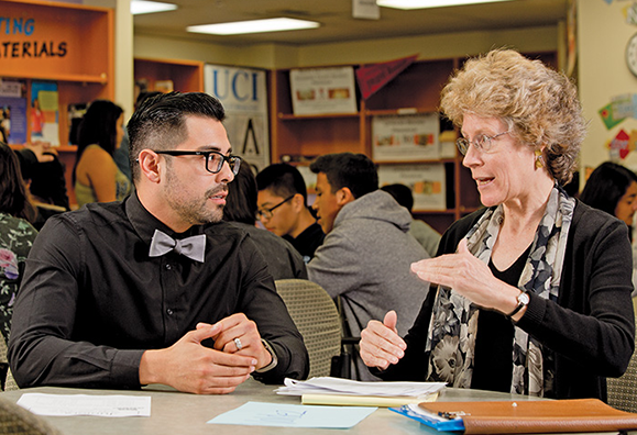 Sara Lundquist, vice president of student services at Santa Ana College, is the recognized leader of the Santa Ana Partnership. Here, she talks with Javier Valdez, a counselor at Valley High School.